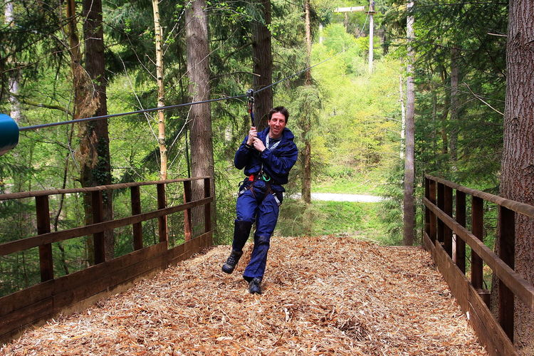 Mature Man Zip Lining At Forest