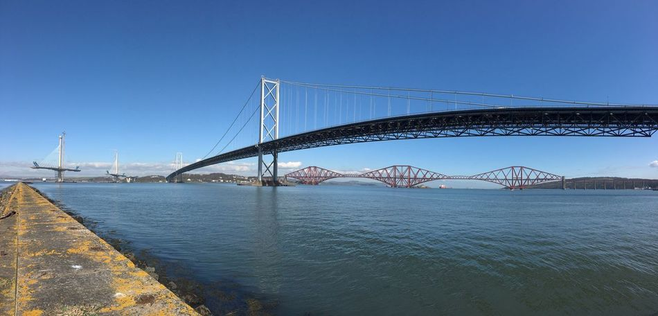 Forth Rail Bridge framed beneath the Forth Road Bridge. ForthRailBridge ForthRoadBridge  Panorama Panoramic ForthBridge Southqueensferry RiverForth Scotland Wide Angle Spring Springtime Landscape ForthCrossing Construction