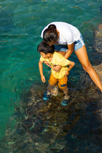 Mother and son in sea