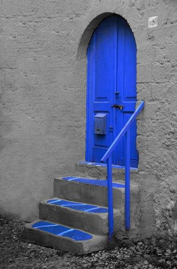 Close-up of blue closed door of building