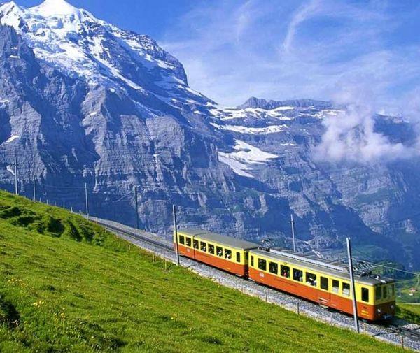 it is mountain range with train passing. wonderful nature. Mountain Range