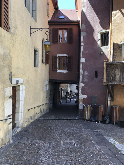 Empty alley amidst buildings in town