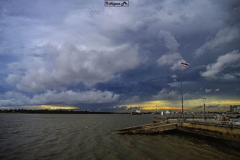 Cloud - Sky Sky Water Flag Nature Architecture Sea Patriotism Built Structure Beauty In Nature Beach No People Building Exterior Scenics - Nature Outdoors Land Transportation