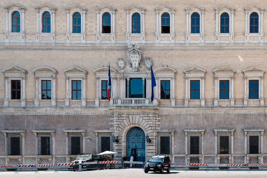 Police in Farnese Palace in Rome, actually Embassy of France Embassy Of France Farnese Palazzo Arch Architectural Column Architecture Building Exterior Built Structure Car City City Street Day Embassy No People Outdoors Palace Police Police Car Protection Transportation Travel Destinations