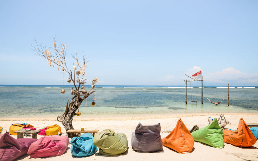 Colorful Bean Bags At Beach On Sunny Day