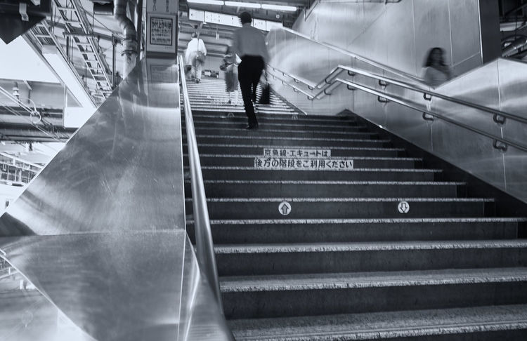 Motion Blur Stairs Architecture Built Structure Escalator High Angle View Incidental People Indoors  Lifestyles Men Metal Morning Commute Motion Moving Up People Public Transportation Railing Real People Slow Shutter Staircase Steps And Staircases Text Train Station Transportation Travel Waling Around Walking