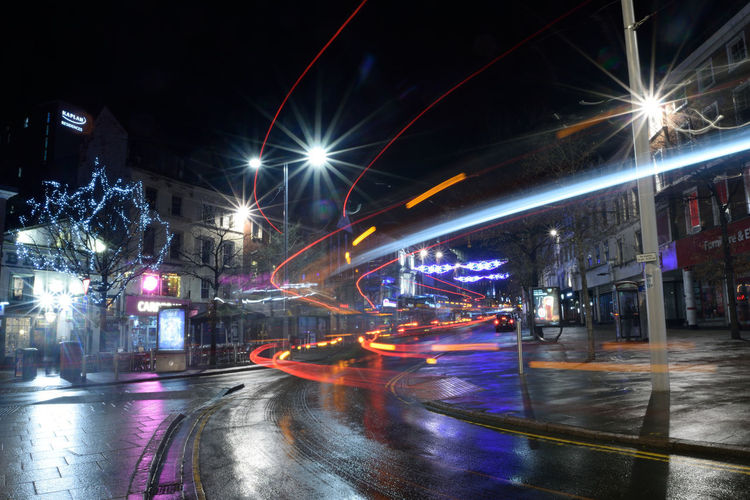 Light trails on Nottingham Market Square Light Trail Light Trails Light Trail Photography Bus Nottingham Market Square Nottingham Market Square Night Illuminated Rain Water Wet City Road Outdoors Mobility In Mega Cities
