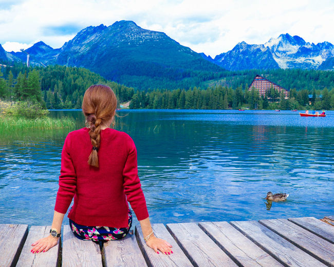 Girl looking at Tatra mountains, Slovakia Alone Woman Slovak Nature Cottage In The Woods Cottage Cottage Lake Crystal Clear Water Lake View Mountains View Duck At The Lake Woman In Red Sitting Alone Brunette Girl  Hairstyle Braided Hair Tatra Mountains Tatra Tatras Tatramountains Tatras Mountains Tatra National Park Tatry Strbske Pleso Strbskepleso Water Mountain Lake Women Beauty Landscape Freshwater My Best Photo