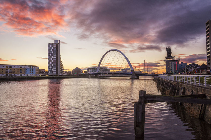 Clyde Arc at sunset Arch Bridge Bridge Bridge - Man Made Structure Built Structure Clyde Clyde Arc Engineering Famous Place Railing Red River Sky Sunset Waterfront