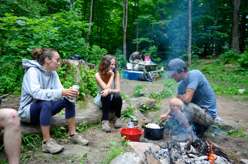 Camping Stove Full Length Togetherness Sitting Eating Friendship Young Women Bonding Domestic Life Barbecue