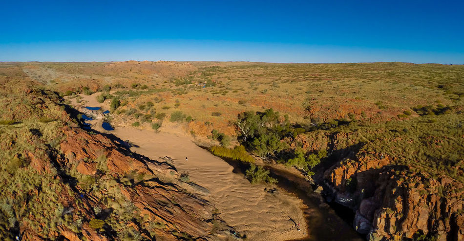 Travelling outback in Western Australia near Nullagine in the Pilbara region. Arid Climate Australia Australia & Travel Australian Landscape Beauty In Nature Camping Desert Gorges Landscape Nature Nullagine Outback Australia Outdoors Pilbara Ravine River River Bed Rocky Landscape Tranquil Scene Tranquility Western Australia