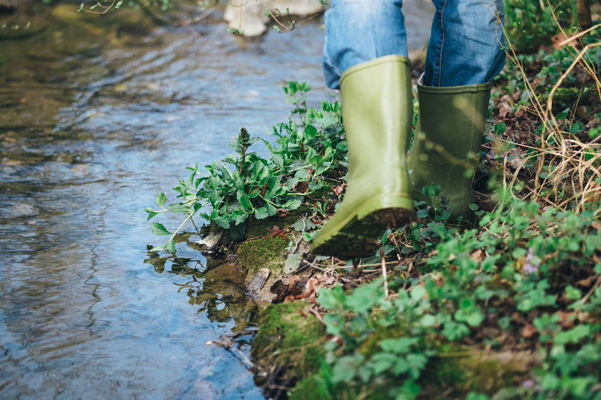 Man Walking Around Legs Mud River Rubber Boots Water