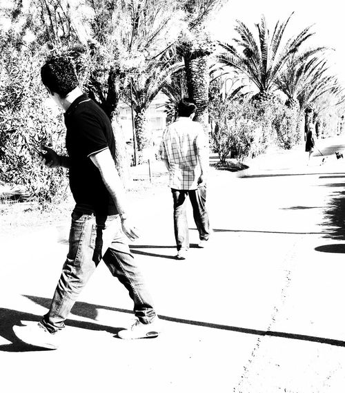 Walkin' IPhoneArtism Mob Fiction Shootermag AMPt_community People Black & White Blackandwhite Streetphotography Street Photography NEMstreet