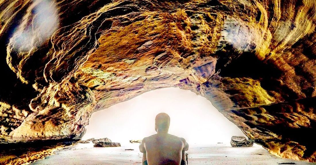 Caveman Real People Rear View Water Leisure Activity Nature Men Lifestyles Sea Standing Reflection Day Outdoors Adult Beauty In Nature Cave