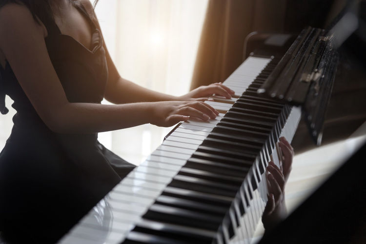 Hand kids practice play piano for up skill of music ability for future occupation.