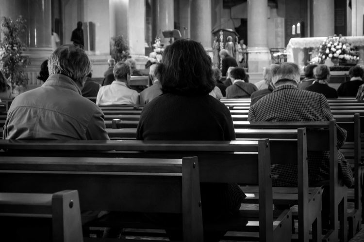 Rear view of people sitting in church