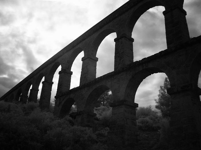 Architecture Built Structure Day History Infrared Photography No People Outdoors Roman Aqueduct - District Of Tarragonés - Tarragona Sky The Aqueduct Of Les Ferreres Better Known As El Puente Del Diablo