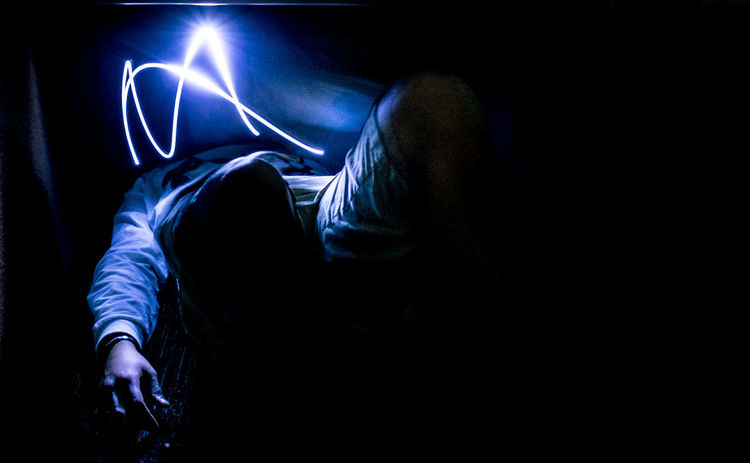 Dazed Light Painting Black Background Blue Light Close-up Dark Dazed And Confused Dizzy Hooded Shirt Illuminated Indoors  One Person Pin Light Be. Ready. See The Light EyeEm Ready   EyeEm Ready   AI Now