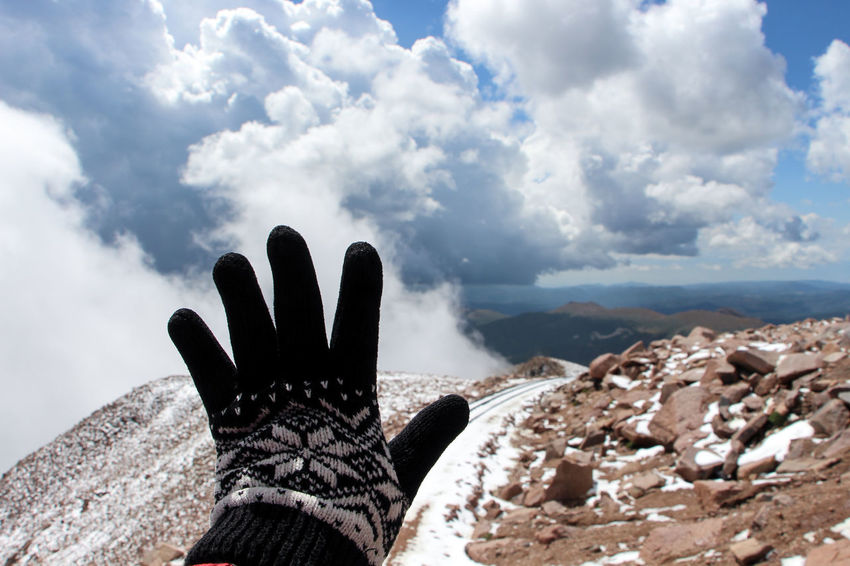 Pikes peak! Cloud - Sky Cloudy Cold Temperature Ice Age A Bird's Eye View Focus On Foreground Hand Gloves Hands Human Finger Limb Mountain Mountain Peak Mountain Range Mountain View Mountains And Sky Outdoors Palm Person Personal Perspective Pikes Peak Remote Sky Tranquil Scene Tranquility Unrecognizable Person Shades Of Winter