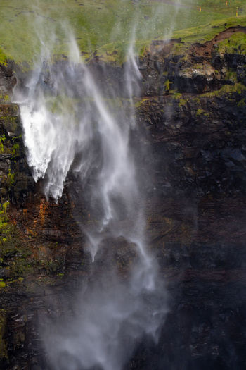 Beauty In Nature Blurred Motion Day Environment Faroe Islands Flowing Flowing Water Land Motion Múlafossur Nature No People Non-urban Scene Outdoors Plant Power In Nature Rock Rock - Object Scenics - Nature Smoke - Physical Structure Solid Tranquility Water