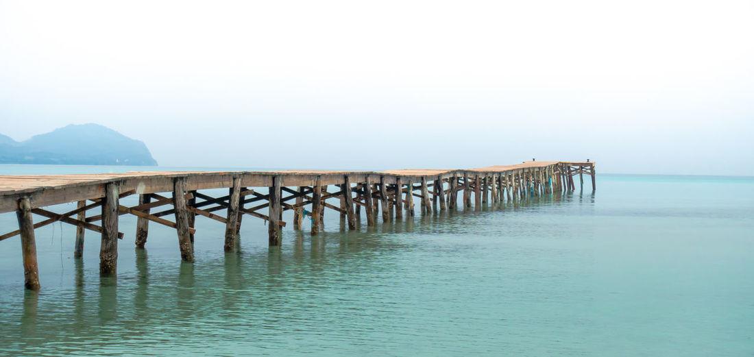 Wooden Pier In Sea Against Clear Sky