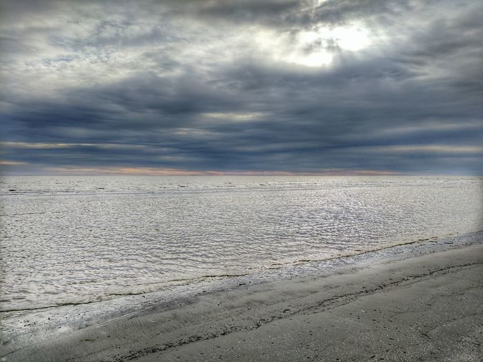 Dramatic Sky Cloud - Sky Outdoors Sand Sunset Landscape No People Nature Storm Cloud Day Sky Wet Vacations Horizon Over Water Beauty In Nature Nature Beautiful Tranquil Scene Tranquility Dramatic Sky Sea Beach Kiawah Island Kiawah Beach Kiawahisland