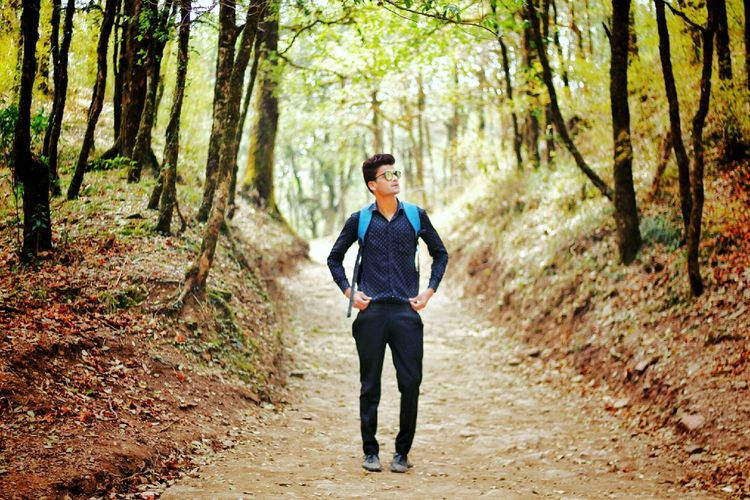 Forest Only Men Healthy Lifestyle Outdoors Nature Hiking Men One Person Jogging Exercising Front View One Young Man Only Adults Only One Man Only Young Adult Adult Smiling People Lifestyles Sport