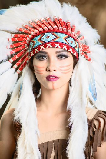 Portrait Of Young Woman Wearing North American Tribal Costume