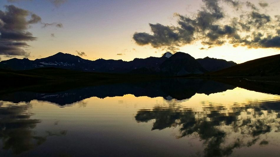 Reflection Water Sky Mountain Scenics - Nature Tranquility Cloud - Sky Tranquil Scene Lake Beauty In Nature Nature Sunset Landscape No People Silhouette Reflection Lake Travel Destinations Mountain Range France Rhône-Alpes Frenchalps Tranquility Val D'Isere Montagne