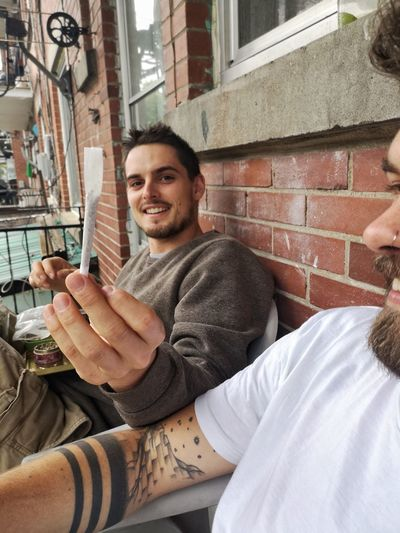 City Friendship Smiling Portrait Men Happiness Cheerful Sitting Wireless Technology Communication