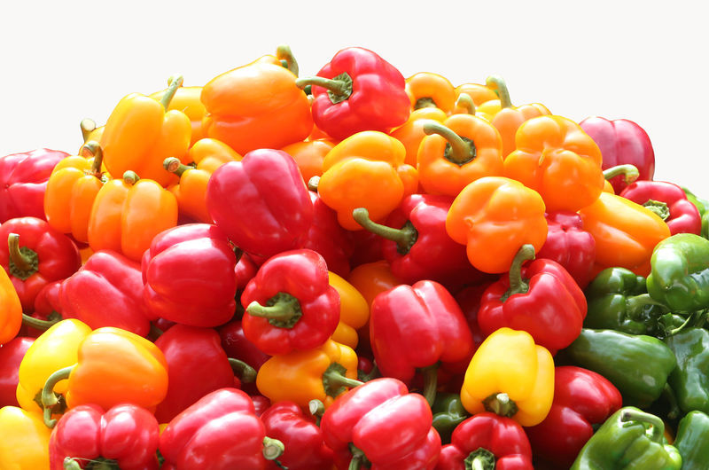 Close-up of colorful bell peppers against white background