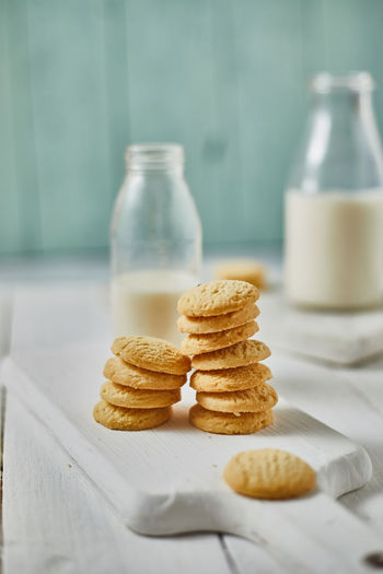 Cookies by milk in bottle on table