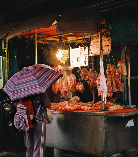 meat stall, taipei ASIA Chiken Food Illuminated Large Group Of Objects Meat Person Pork Raining Retail  Selling Stall Taipei Taiwan Three Quarter Length Travelling Umbrella