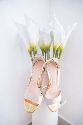 Wedding Bride Shoes Hanging Flower Vase Close-up Day Flower Shoes Vase Wedding