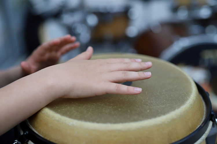 Close-up of hands playing drum