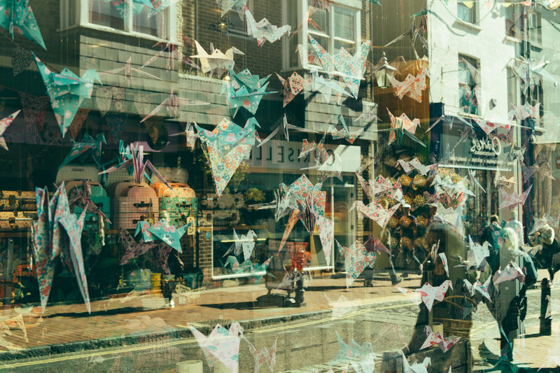 Activity in Brighton displays.. Paper Graffiti Built Structure Architecture Street Art Building Exterior Outdoors Day No People Multi Colored Exploring Origami Exploring Brighton City Life Urban Tones Photography Check This Out Shop Structure Lines And Shapes Focus Busy