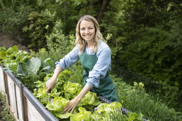 Portrait of smiling woman standing in farm