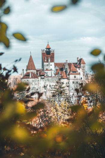 Built Structure Architecture Building Exterior Building Tree Place Of Worship Plant Nature History Religion The Past Sky Cloud - Sky No People Belief Spirituality Selective Focus Day Outdoors Spire  Branch Castle Bran Castle Romania Leaves