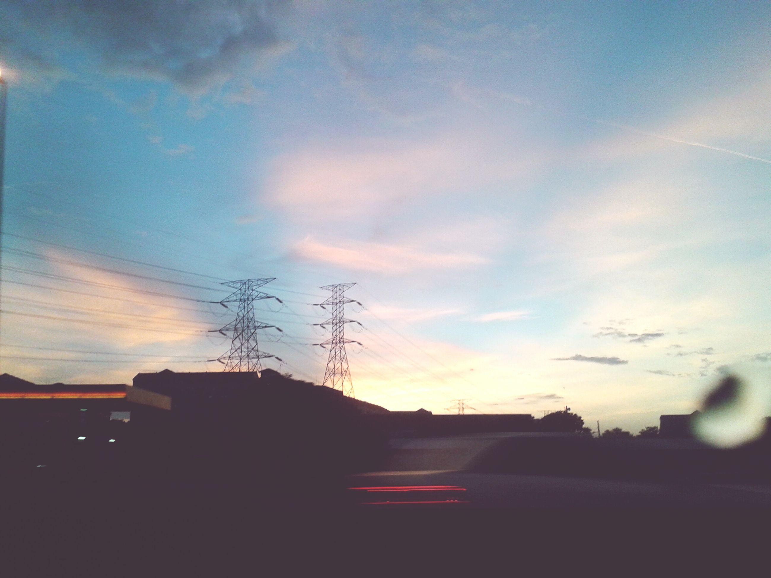 building exterior, architecture, built structure, silhouette, sky, power line, sunset, electricity pylon, low angle view, house, electricity, cloud - sky, cable, cloud, residential structure, dusk, power supply, building, connection, residential building