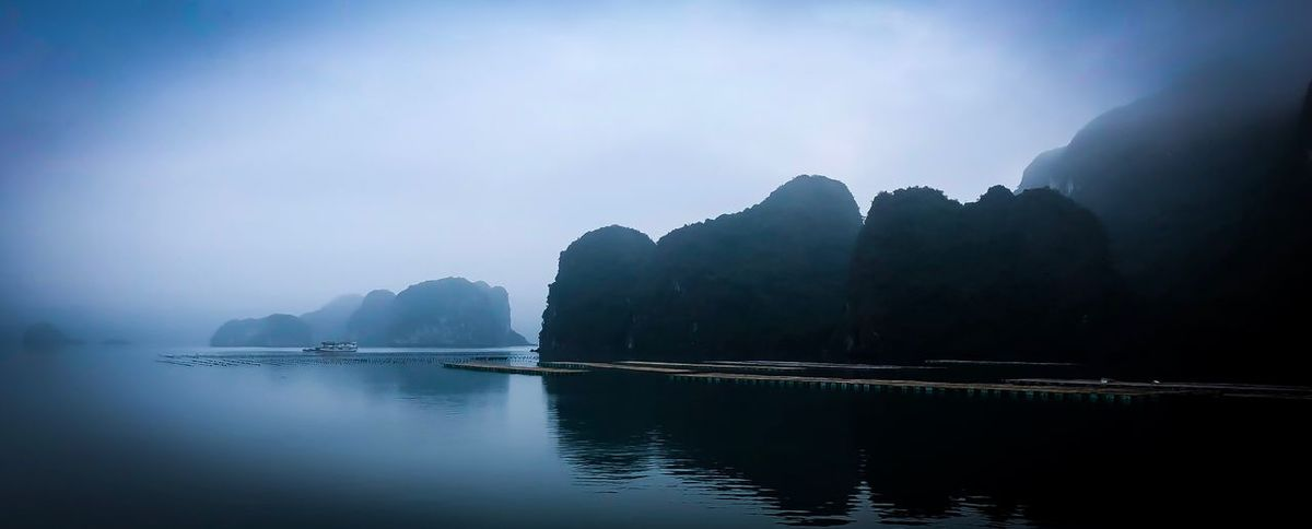 Moody Veitnam Halong Bay Vietnam Water Nature Beauty In Nature Scenics Mountain Tranquil Scene Tranquility Outdoors Sky Fog No People Day First Eyeem Photo