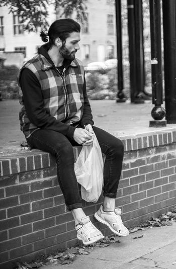 Adult Adults Only Architecture Black And White Casual Clothing City Day Documentary Front View Full Length Leisure Activity Lifestyles One Person Outdoors Pattern Real People Sidewalk Streetphotography Young Men Bnw_collection