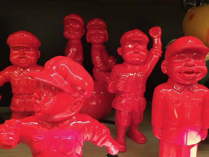 Close-up of toys with red statues