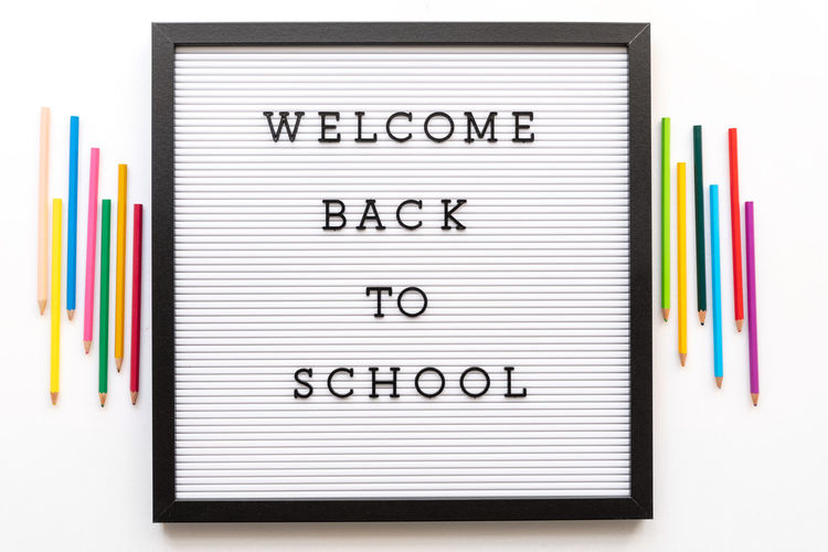 Welcome back to school notice on message board. Board Message White White Background Isolated School Education Class Pencil Pencil Drawing Multi Colored Indoors  Studio Shot Text Spiral Notebook No People Office Paper Rubber Writing Instrument Note Pad Colored Pencil Pen Large Group Of Objects Directly Above Close-up