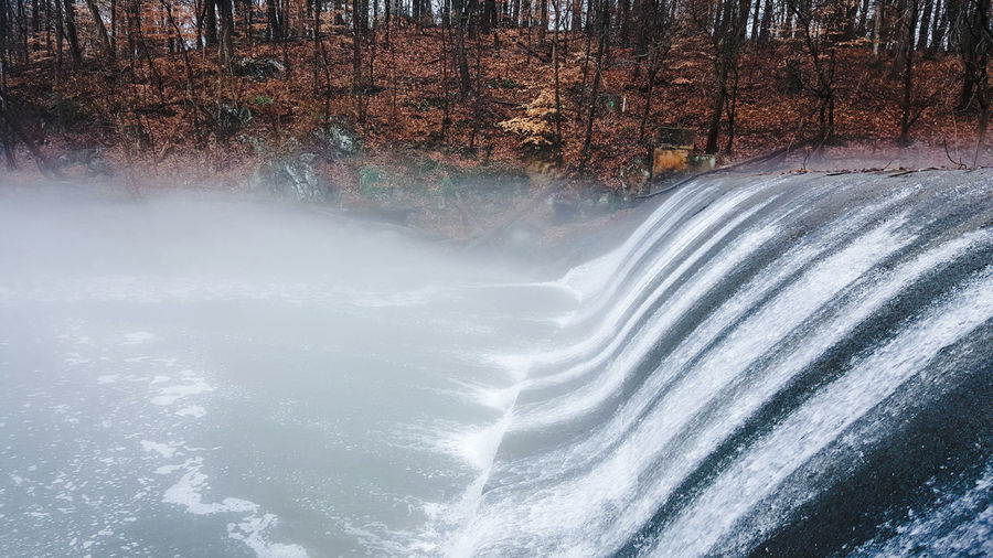 Up close with Burnt Mills Dam. Burnt Mills Dam Silver Spring, Maryland, USA Water Waterfall Dam Tree Backgrounds Sky Close-up Weather Foggy Weather Condition Cold Temperature Cold Winter Rainy Season