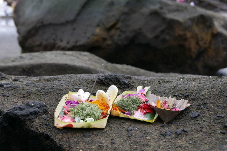 Close-up of religious offerings on rock