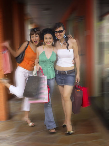 shopping at clothing store Asian  Business Fashion Free Time Happiness Shopping Clothing Store Consumerism Discount Enjoying Life Female Front View Fun Time Garment Leisure Activity Lifestyles Motion Retail  Sales Shopping Bag Shopping Mall Smiling Weekend Activities Women