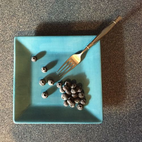 Directly above shot of blueberries in plate on table