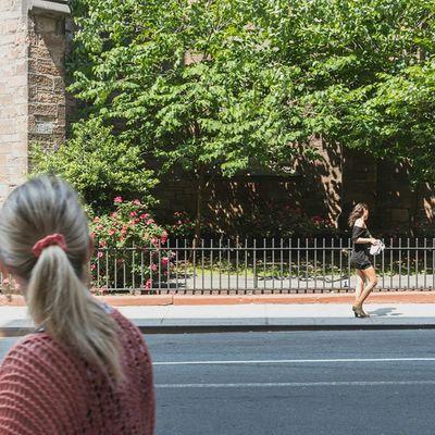 Girl on the SidewalkAcross near Old Limelight Streetphotography 50mm urban NYC avenueofamericas chelsea