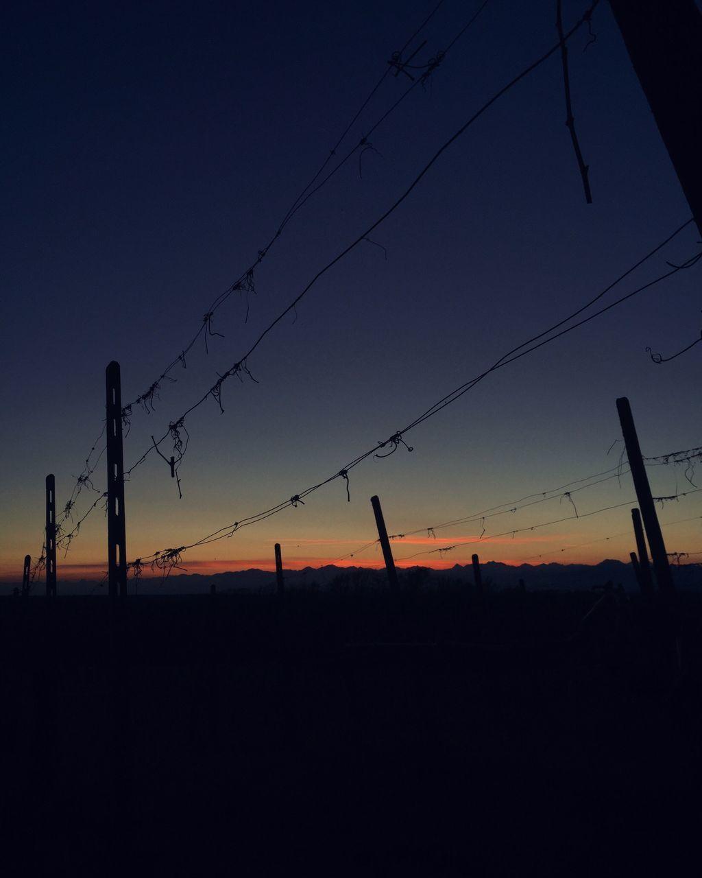 sunset, silhouette, cable, orange color, connection, nature, power line, sky, electricity pylon, beauty in nature, electricity, power supply, outdoors, no people, landscape, telephone line, scenics, clear sky