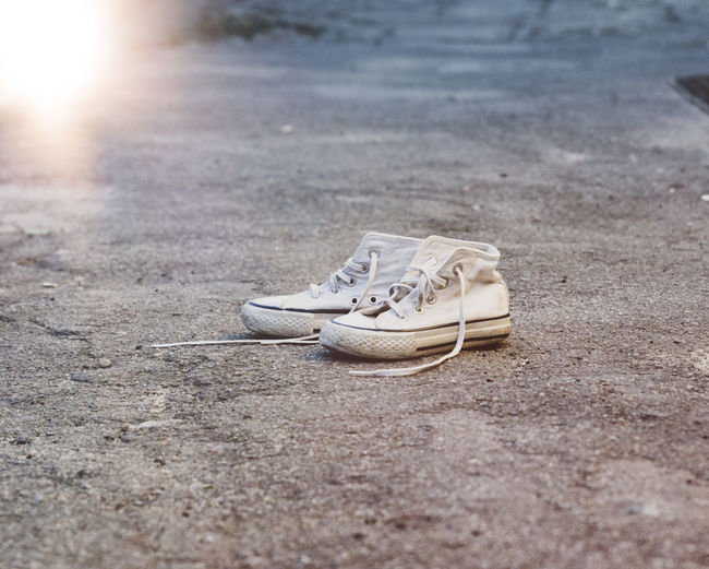 Absence Canvas Shoe City Close-up Compatibility Day Lace - Fastener Land Nature No People Outdoors Pair Personal Accessory Selective Focus Shoe Shoelace Sole Of Shoe Sport Sports Shoe Still Life Street Surface Level